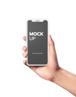Mão segurando a maquete de celular branco