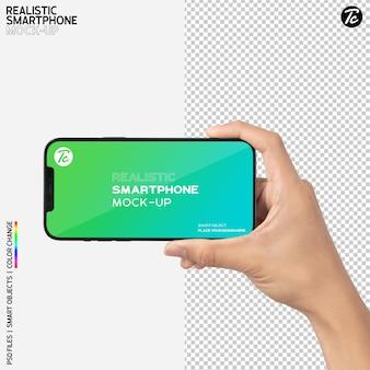 Mão segurando a maquete do smartphone