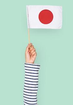 Mão, segurando, bandeira japonesa
