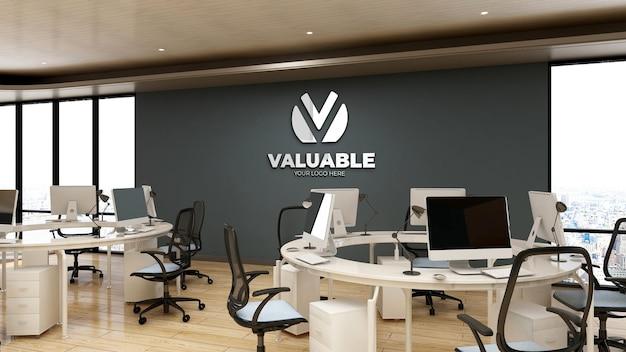 Maquete 3d do logotipo da empresa no espaço de trabalho do escritório Psd Premium