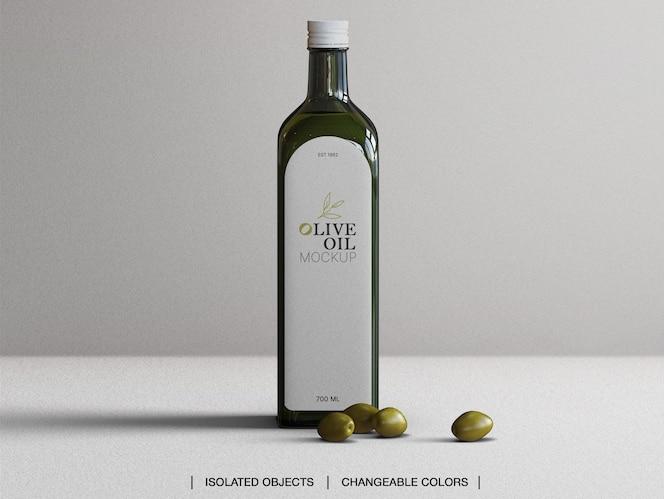 Maquete da garrafa de vidro de azeite de oliva com azeitonas