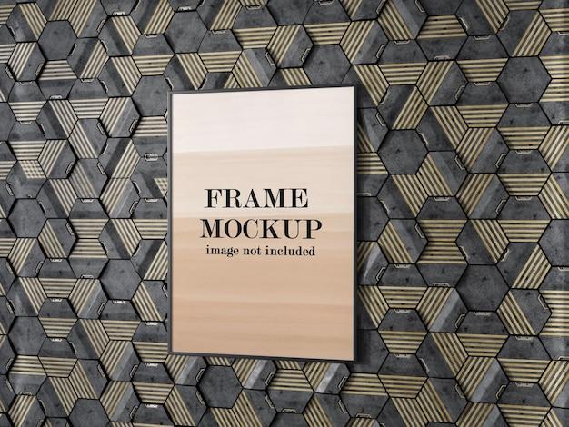 Maquete da moldura da foto fixada no painel de parede