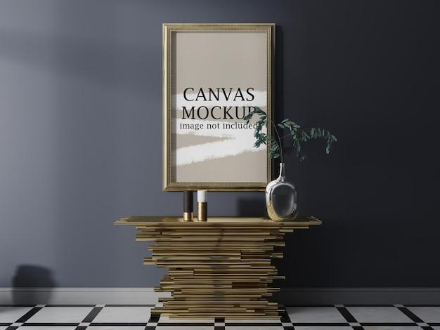 Maquete da moldura de lona dourada na parede cinza