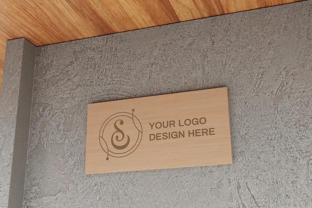 Maquete da placa de sinalização do logotipo na parede de concreto
