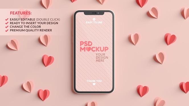 Maquete da tela do celular com corações de papel rosa e vermelho em renderização 3d