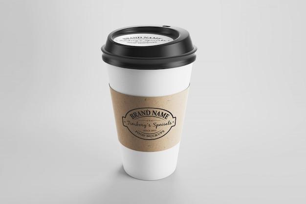 Maquete da xícara de café de papel eco com adesivo e boné