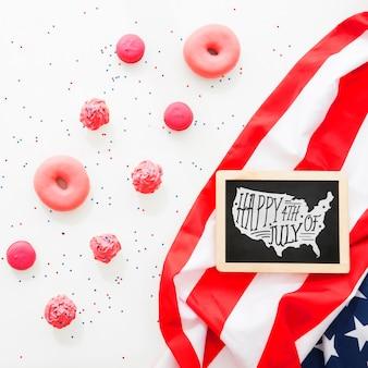 Maquete de ardósia com donuts rosa
