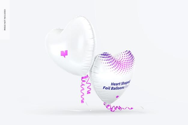 Maquete de balões de folha em forma de coração, caindo