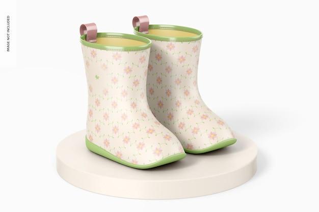 Maquete de botas de chuva infantil, na superfície