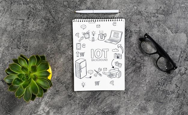 Maquete de caderno com óculos