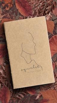 Maquete de caderno de igualdade marrom em branco