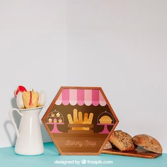 Maquete de café da manhã com moldura hexagonal e pão