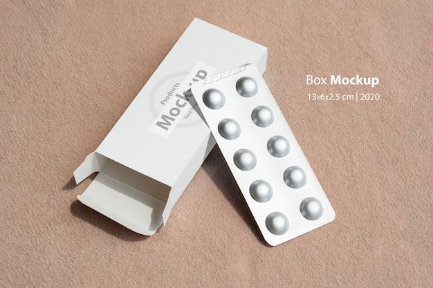 Maquete de caixa de comprimidos com comprimidos