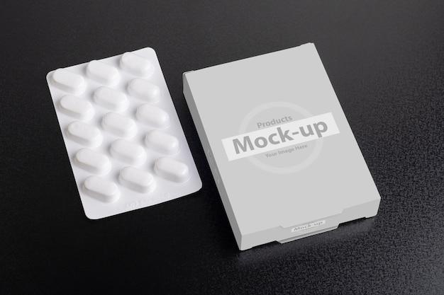 Maquete de caixa de comprimidos com pão no escuro
