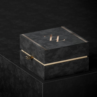 Maquete de caixa de presente de joia preta para marca em fundo preto renderização 3d