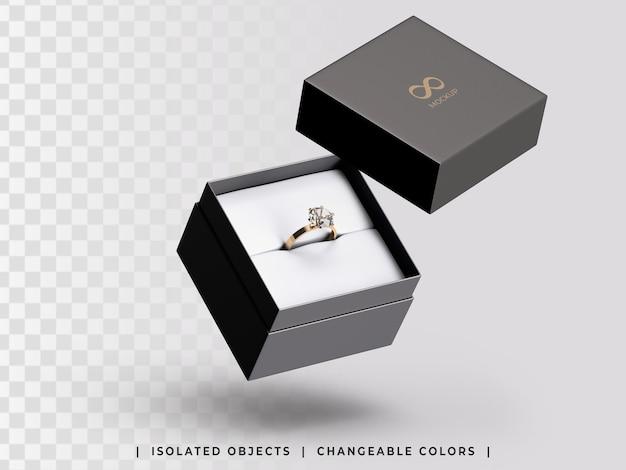 Maquete de caixa de presente de joias com anel dourado flutuante isolado