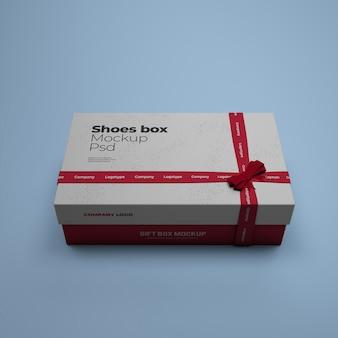 Maquete de caixa de sapatos com cor de fundo editável psd