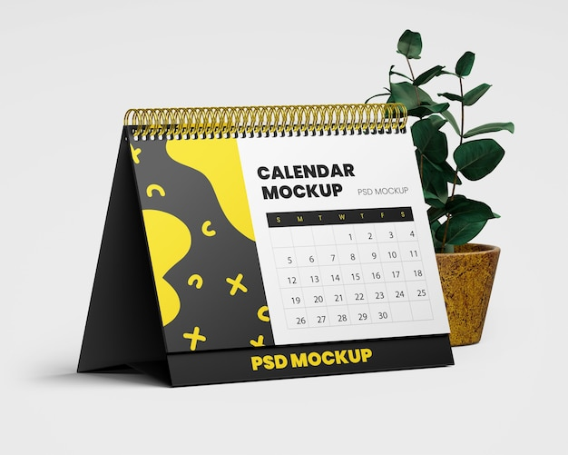 Maquete de calendário de mesa em espiral com planta