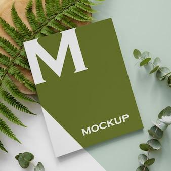Maquete de capa de revista natureza plana com arranjo de folhas