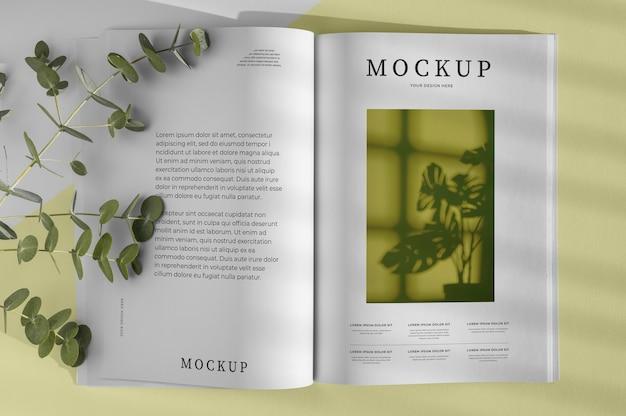 Maquete de capa de revista natureza plana com composição de folhas