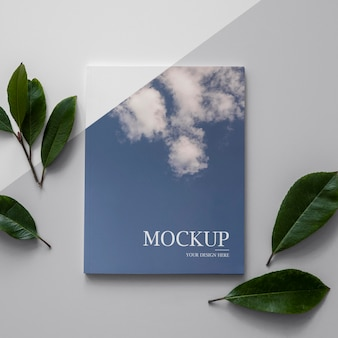 Maquete de capa de revista natureza plana com folhas