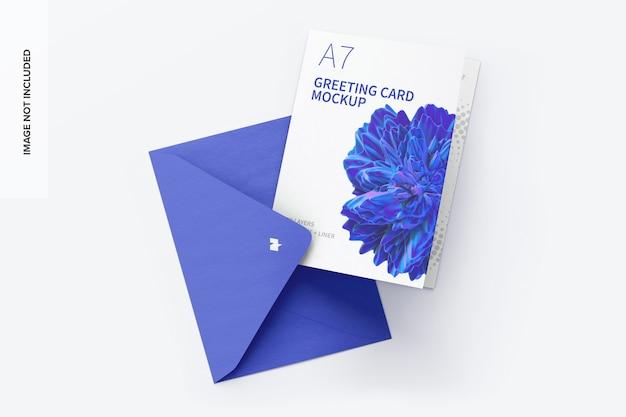 Maquete de cartão comemorativo com envelope, vista superior