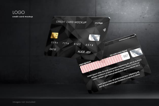 Maquete de cartão de crédito premium em fundo escuro de concreto