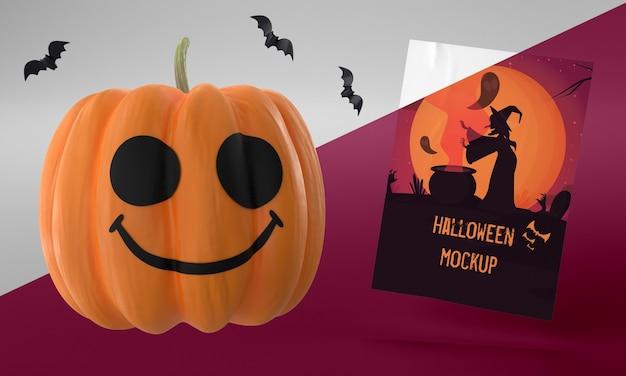 Maquete de cartão de halloween com abóbora sorridente