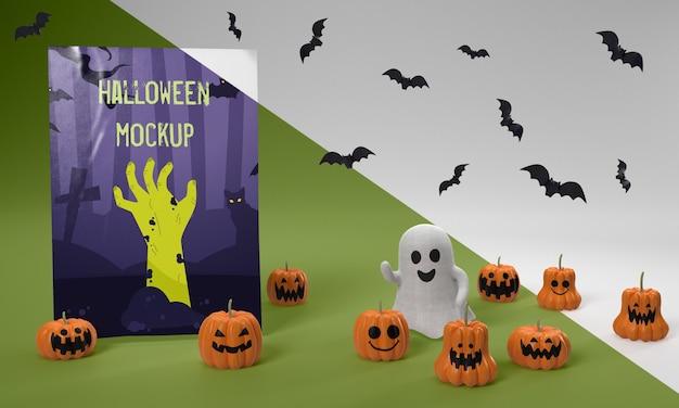 Maquete de cartão de halloween com abóboras assustadoras e fantasmas