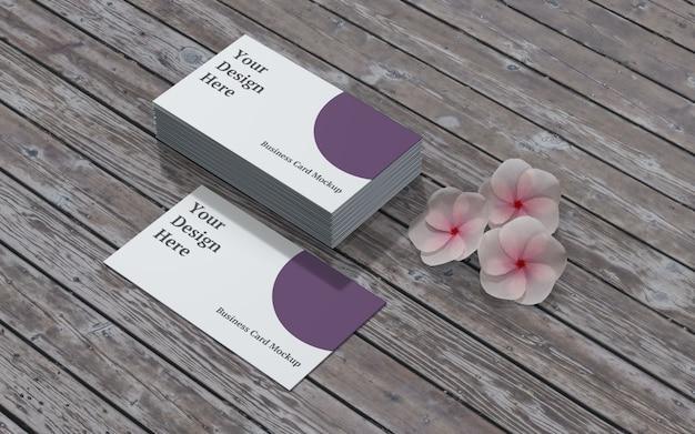 Maquete de cartão de visita com flor e madeira vista esquerda
