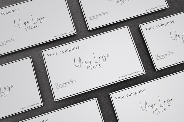 Maquete de cartão de visita com fundo preto de textura