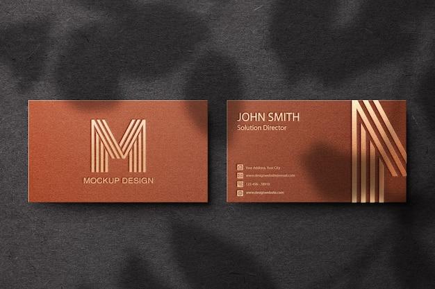 Maquete de cartão de visita com sombra de folhas horizontal