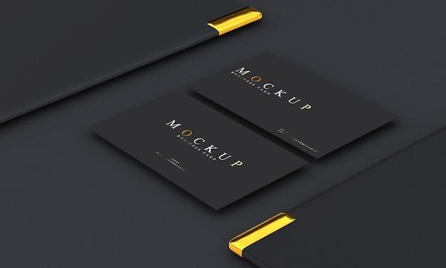 Maquete de cartão de visita de design de luxo em tons de ouro e preto