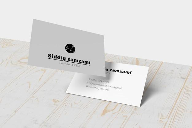 Maquete de cartão de visita de fundo de madeira realista