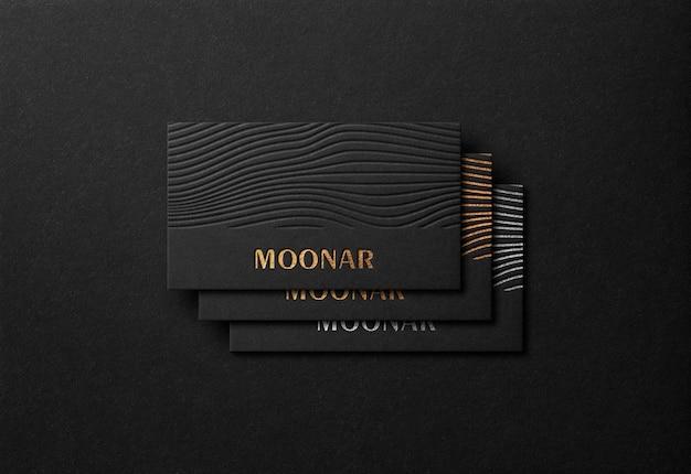 Maquete de cartão de visita de luxo com efeito tipografia ouro