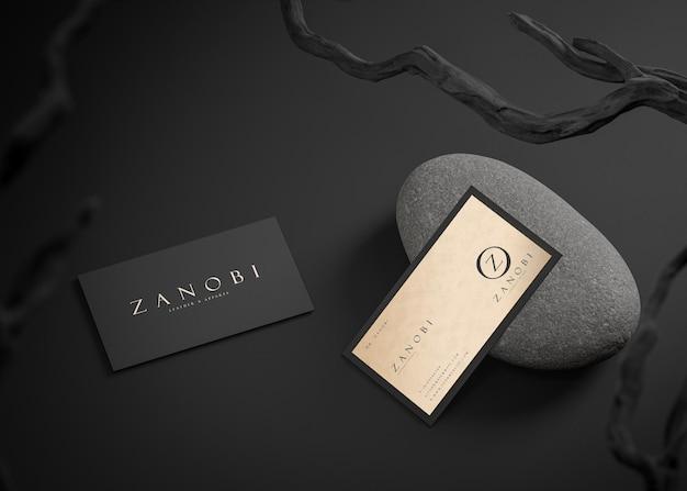 Maquete de cartão de visita de luxo preto em ouro tipográfico para identidade de marca renderização em 3d