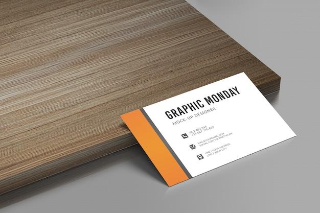 Maquete de cartão de visita elegante realista de fundo de madeira psd grátis