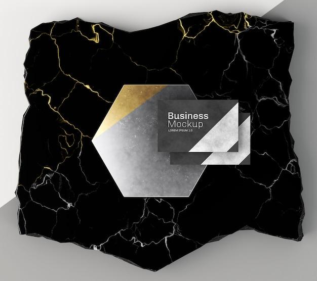 Maquete de cartão de visita em cima da vista superior de mármore