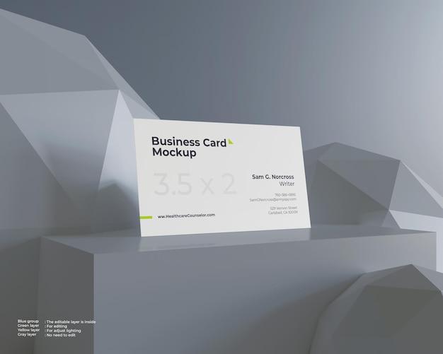 Maquete de cartão de visita em superfície de geometria de bloco e esfera