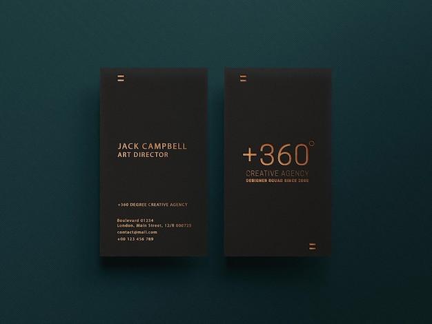 Maquete de cartão de visita escuro com efeito dourado luxuoso