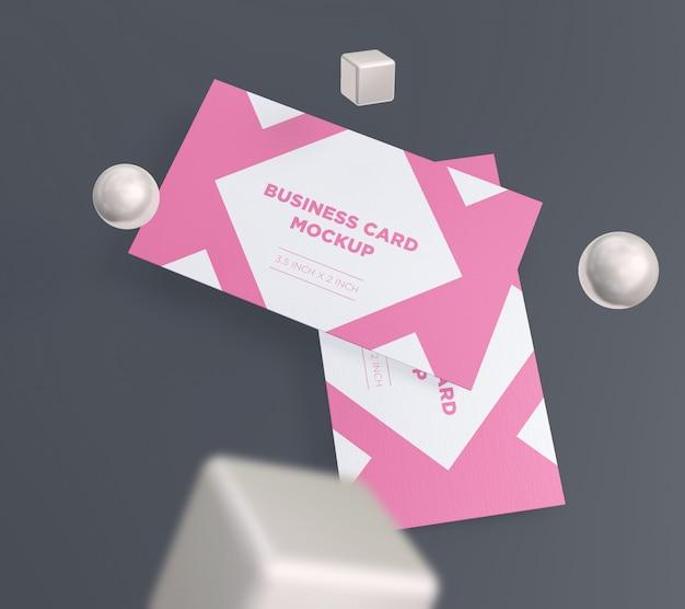 Maquete de cartão de visita minimalista com bola e caixa