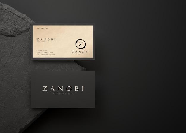 Maquete de cartão de visita moderno luxuoso em preto e dourado para identidade de marca renderização em 3d