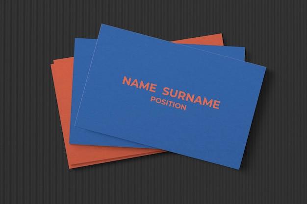 Maquete de cartão de visita simples em tons de azul e laranja
