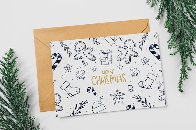 Maquete de cartão e envelope com conceito de natal
