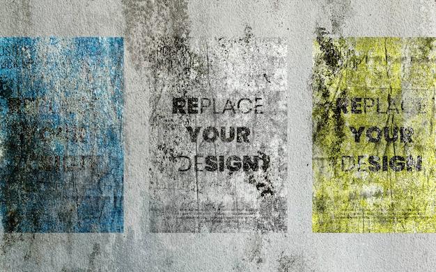 Maquete de cartazes antigos na parede de concreto