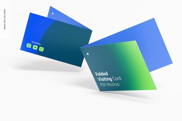 Maquete de cartões de visita dobrados, caindo