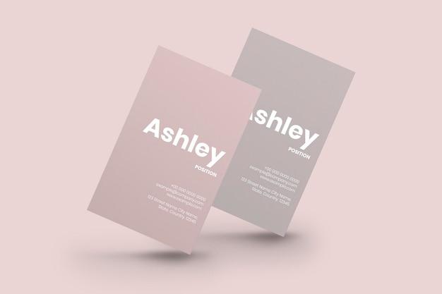 Maquete de cartões de visita em tom rosa com vista frontal e traseira