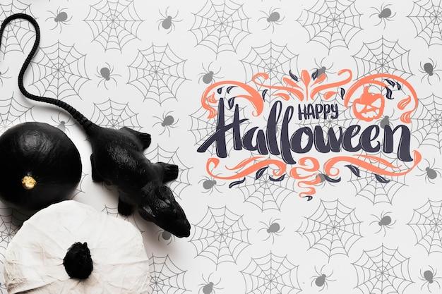 Maquete de conceito de halloween com abóboras e ratos