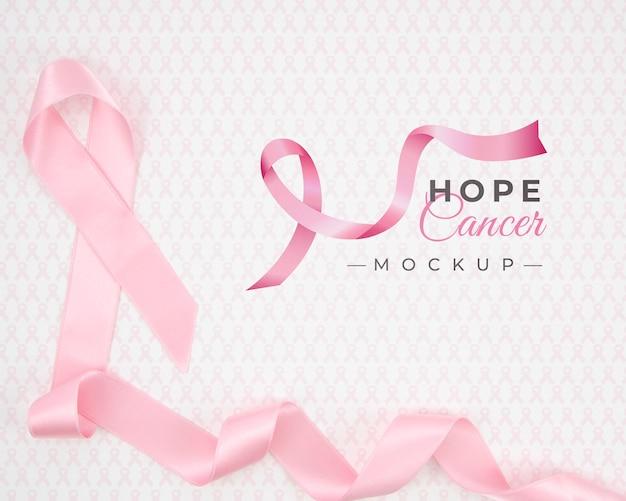 Maquete de conscientização do câncer de mama com fita rosa