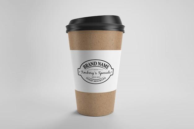 Maquete de copo de café eco papel marrom com tampa e etiqueta de papel